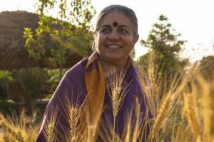 VANDANA-SHIVA-speaker-nextgengallery-vandana-shiva-in-wheat-field-[eviltwinbooking(dot)org]